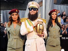 Sacha Baron Cohen, in full Dictator costume, proudly displays an urn carrying the faux remains of late North Korean dictator Kim Jong Il, on the Academy Awards red carpet – just moments before dumping the ashes on E! host Ryan Seacrest. More candid Oscar shots: http://bit.ly/zJLXtv