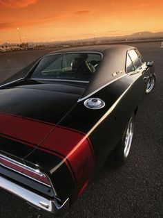 Even though I prefer European autos aka VW, I still love a good classic American muscle car.   1969 dodge charger pro touring.