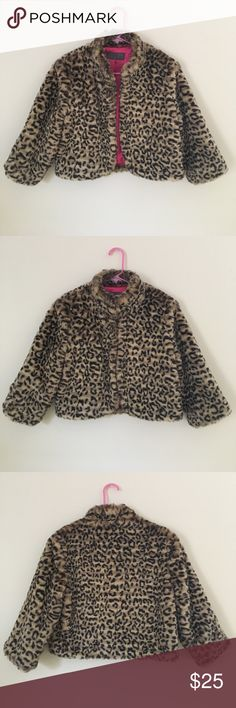 """Paper Doll Leopard Faux-Fur Cropped Jacket Super cute faux-fur, cropped jacket with 3/4 sleeves and stand-up collar. Satin hot pink lining shows some slight wear as pictured, but exterior is like new. With three large hook and eye clasps, it can be worn closed or open in the front. Length from shoulder to hem is 17"""". Paper Doll Jackets & Coats Capes"""