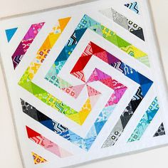 """Celebrating for the Birth of """"L's Modern"""" BASICS 58 COLORS + 2015 SPRING 48 COLORS = 106 COLORS! Are you driven by """"Rainbow Quilt"""" lately? We've got the perfect vehicle for you!! We are so excited to share this gorgeous """"Rainbow Swirl Quilt"""" made by Sedef Imer @downgrapevinelane please visit her blog www.downgrapevinelane.com to see how much fun she had working with L's Modern!! ❤️ #lsmodern #Lsmodern2015spring #Lecien #Lecien_fabrics #colors #quiltart #HaveFunwithLsModern #rainbowquilt"""