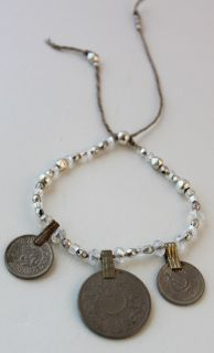 item #B047 Gypsy magic-is made to reflect the mystical world of gypsy wanderers- antique coins are surrounded by glittering clear glass beads and shiny silver plated beads-which make this bracelet a true dream.