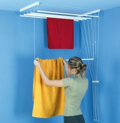 Dryers RANK What we have here is a unique compact laundry dryer that incorporates the function and design of a full size dryer. If you're living in a small apartment, you need a minimized dryer that provides a […] Indoor Clothes Lines, Vintage Laundry, Clothes Dryer, Pulley, Apartment Design, Shopping Hacks, Contemporary Style, Outdoor Blanket, Ceiling