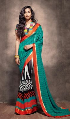 Black, coral and sea green georgette sari makes you center of attraction of everybody's eyes. The sari has checks and lines pattern block print and woven lace. Sari comes with matching stitched blouse as shown in the picture. #PrintedDesignCasualSaree