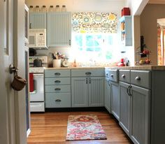 The Ironstone Nest: Transformation Tuesday - September 25, 2012    love the painted kitchen cabinets... happy kitchen colors