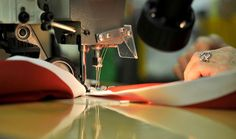 A sewing machine quickly places the header on a Canadian flag. MARK WANZEL PHOTO Canadian Flags, National Symbols, News Stories, Header, Sewing, Places, Dressmaking, Couture, Stitching