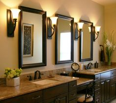 Drop down make-up area....dark cabinets combined with granite...dark bronze faucets..3 mirrors and nice lamps