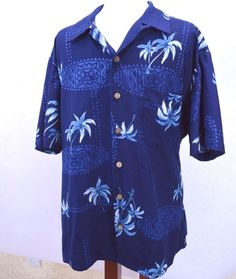 This fun Tiki print Hawaiian shirt from Kennington Limited is ready for any casual occasion! -The fabric design is a combination of tiki design surf boards and palm trees. -This is a more sedate shirt, perfect for when you need a 'quieter' Hawaiian shirt.   eBay!