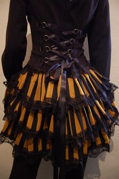 Steampunk Bustle Jacket, super cute! I'm thinking if I can find a jacket that looks right and is a little large in the body I can sew on some rings to make a faux corset in the back...