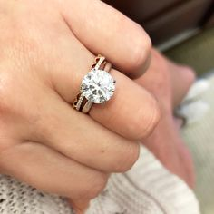 This 3.50 ct round brilliant diamond sits in a 4-prong solitaire engagement ring setting and is paired with a stackable wedding band from Classique. #3carat #round #diamond #4prong #solitaire #engagementring #stackable #weddingband