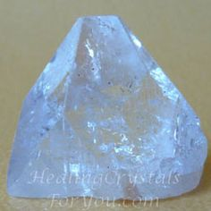 Clear Apophyllite pyramid...Apophyllite stones have a high vibration that will raise your spirits, and spiritually energize your being. The lovely clear pyramids are particularly wonderful to work with, as they stimulate your pineal gland and help to open you up to spiritual awakening... by infusing your light-body with high vibration energy.