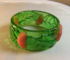 Thistle bangle carved from vintage green prystal bakelite.  Almost like wearing candy!
