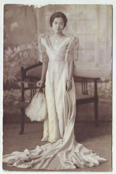 Filipina lady wearing traditional terno dress. Photo taken c. 1920's in Manila, Philippines.