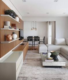 The slatted wooden panel and the coffee table bring sophistication to the TV room. Living Room Tv, Home And Living, Home Tv, Living Room Designs, Modern Design, Sweet Home, New Homes, House Design, Web Design