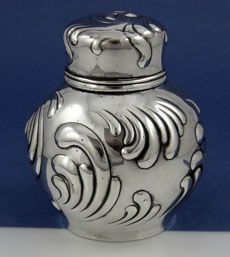 "Large Tiffany Sterling Tea Caddy  A large bulbous form Tiffany sterling silver tea caddy with a swirl decoration on the body, lid and inner cap. Height 4 1/2""; width 3 3/4"". Excellent weight and condition 9.85 troy ounces."