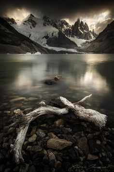 Dark sky above the Cerro Torre peak, from the coast of Lago Torre. I liked this serene and calm atmosphere... The wind was calm enough to have some partial reflections on the lake.   Argentina, Patagonia.  © Xavier Jamonet
