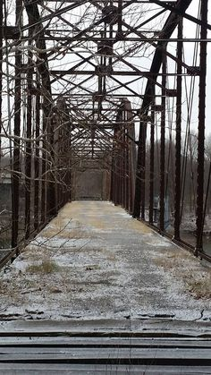 Beautiful old bridge covered in a light dusting of snow near Pryor, Oklahoma. Photo by Rena Rowland-Brown.