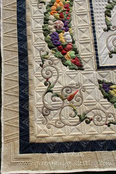 Straight-line or geometric quilting is a good contrast with curvy rounded applique.  Flourish on the Vine - designed by Kathy Wylie, pieced and appliqued by Loanne and quilted by Judi Madsen of Green Fairy Quilts.