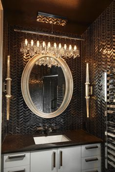 Dark, gleaming herringbone tile helps give this small bathroom a personality larger than its size would suggest. Timeless Bathroom, Beautiful Bathrooms, Foyers, Interior Styling, Interior Decorating, Interior Design, Bathroom Tile Designs, Bathroom Ideas, Bathroom Wall