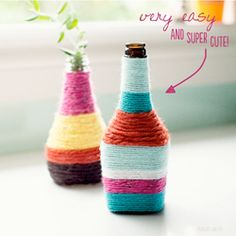 Bottles wrapped with thread and modge podge to create a more colorful look.