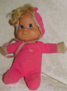 One Of Your Favorite Toys Growing Up-she was a baby beans doll; yours was a solid blue, you got her for your first b-day from Uncle Scott  Cindy and you named her blue baby...her bonnet was always around her neck and you carried her by her blonde hair so much her hair stood straight up.  You lost her at a sleepover.