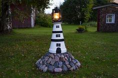 Garden lighthouse, made of clay pots