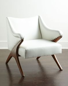"""Contemporary chair. Beechwood frame. Bicast leather upholstery. Nailhead trim. 31.5""""W x 35""""D x 34""""T. Imported. Boxed weight, approximately 58 lbs."""