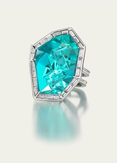 Tamsen Z with a carved Paraiba tourmaline.  Love the unusual use of the baguette diamonds.