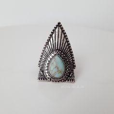 Native Tribal Turquoise Ring Boho Beautiful Native American inspired tribal faux turquoise ring. Silver (NOT .925!). The back expands to accommodate a variety of ring sizes.  Due to lighting- color of actual item may vary slightly from photos. No filters have been applied to alter or misrepresent color or condition.  I'm sorry but I do NOT trade Price is Firm Unless Bundled Act Like a Lady Spotted Fawn Boutique Jewelry Rings