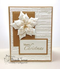 white and gold .. gorgeous Spellbinder's layered poinsettia in white layers ... sheet music embossing folder texture in background ... I have the dies and the embossing folder