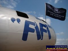 """B-29 """"FiFi"""" of the Commemorative Air Force, with CAF flag and nose art"""