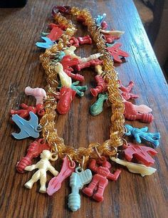 """VINTAGE CELLULOID NECKLACE WITH 39 SPACE RELATED CHARMS 18 1/2"""" LONG NO RESERVE"""