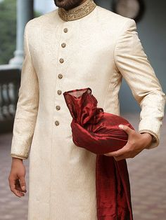 Send us picture of a celebrity or designer sherwani that you will like to wear on your wedding. We will make sherwanis in your choice of color. Fully customized sherwani for grooms. Sherwani For Men Wedding, Wedding Dresses Men Indian, Wedding Outfits For Groom, Groom Wedding Dress, Sherwani Groom, Wedding Men, Cream Wedding, Mens Wedding Attire Summer, Men Fashion