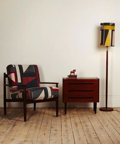 A midcentury chair is reupholstered with Gambell's Abstract Square Print.