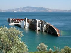 Abandoned - Mediterranean Sky, formerly City of York, lies abandoned in Elevsis Bay, Greece.  This Cruise is over, like shipboard romance, this love boat is sunk.