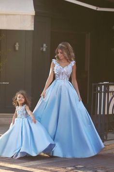 Matching long erases in blue for mother and daughter.adorable