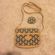 Amazing Vintage Fleur de lis bag & coin purse!❤️ Amazing vintage bag with matching mini coin purse! Measures 8x6 inches, 21 inch strap drop- adjustable belt with 3 notches. Clean synthetic material liner with zippered pocket. Strap is a bit warped from being in a box for a long time. Will probably relax over time with use. Vintage Bags