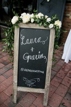 chalk wedding sign + flowers // photo by Brookelyn Photography // http://ruffledblog.com/liberty-warehouse-wedding