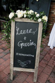 chalk wedding sign + flowers // photo by Brookelyn Photography // http://ruffledblog.com/liberty-warehouse-wedding