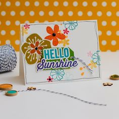 Hello Sunshine Card - Scrapbook.com - Made with Jillibean Soup Saffron Yellow collection. Allow part of the cards embellishments to hang off the page for a fun look.