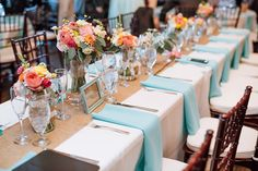 The aqua, teal, tiffany blue and shades of pink, blush, coral, orange and yellow wedding scheme is so cute for this wedding reception table!Photo by Maddie Mae Photography