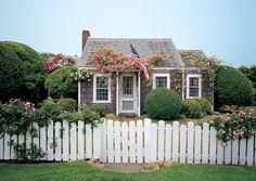 Interior Designer Jeffrey Bilhuber's 1920's Nantucket rose covered cottage is a classic emblem of New England style. via Architectural Digest #Nantucket #cottage