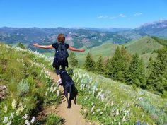 Woman hiking with dog.