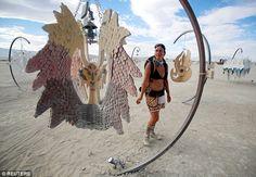 Reveler Sandra Mallet views an art installation at Burning Man as it gets…