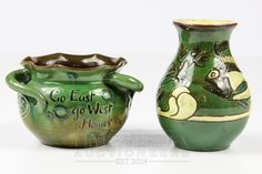 A small C.H. Brannam vase decorated with Sgraffito fish on a dark green ground; and a small three-handled bowl, incised with 'Go East, Go West', 10cm high (2)  £50 - 70