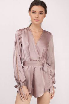Feel confident in this beautiful satin wrap romper!
