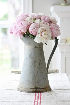 peonies... Norma Ann gave me an old coffee pot that is gonna look sooooo neat filled with peonies just like this!!!
