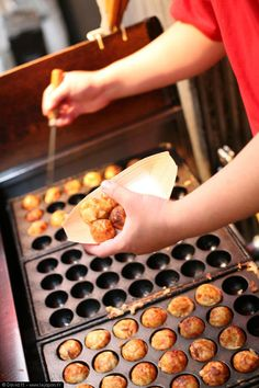 """Takoyaki  ❤   """"a ball-shaped Japanese snack made of a wheat flour-based batter and cooked in a special takoyaki pan. It is typically filled with minced or diced octopus, tempura scraps, pickled ginger, and green onion. Takoyaki are brushed with takoyaki sauce, a sauce similar to Worcestershire sauce, and mayonnaise. The takoyaki is then sprinkled with green laver and shavings of dried bonito."""""""