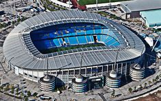 Oasis' favorite side, Manchester City, play their home matches at the Etihad Stadium. Manchester City Football Club, City Of Manchester Stadium, Man City Stadium, Soccer Stadium, Football Soccer, Yankee Stadium, Pep Guardiola, Commonwealth, English Football Stadiums