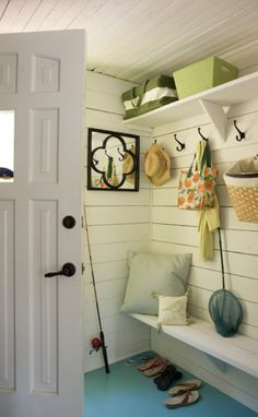 Casual Cottage Entryway In this Laurentians, Que. cottage, a cramped mudroom feels larger thanks to white paint and a teal painted floor. Homeowner Heidi Smith installed the hooks and shelving herself for convenient storage. Cottage Homes, Cottage Style, Cottage Interiors, Cottage Entryway, Pool Shed, Blue Floor, White Cottage, Coastal Cottage, My New Room