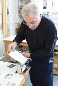 Julian Cox demonstrating printing with a pasta machine.